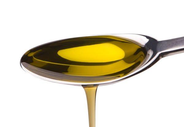 Dos cucharadas soperas de aceite de oliva como máximo